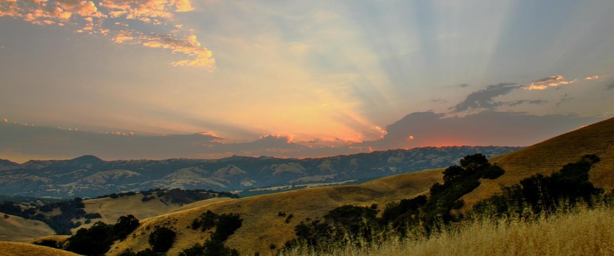 Sunset over golden hills