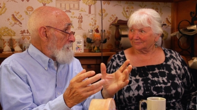 Two Open Space Authority founders talking together at kitchen table
