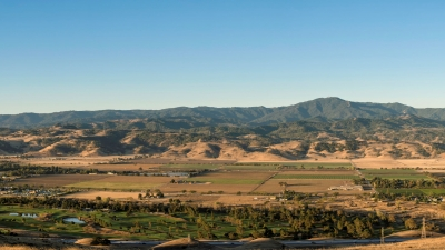 Panorama view of Coyote Valley's fields looking west towards foothills and Santa Cruz Mountains