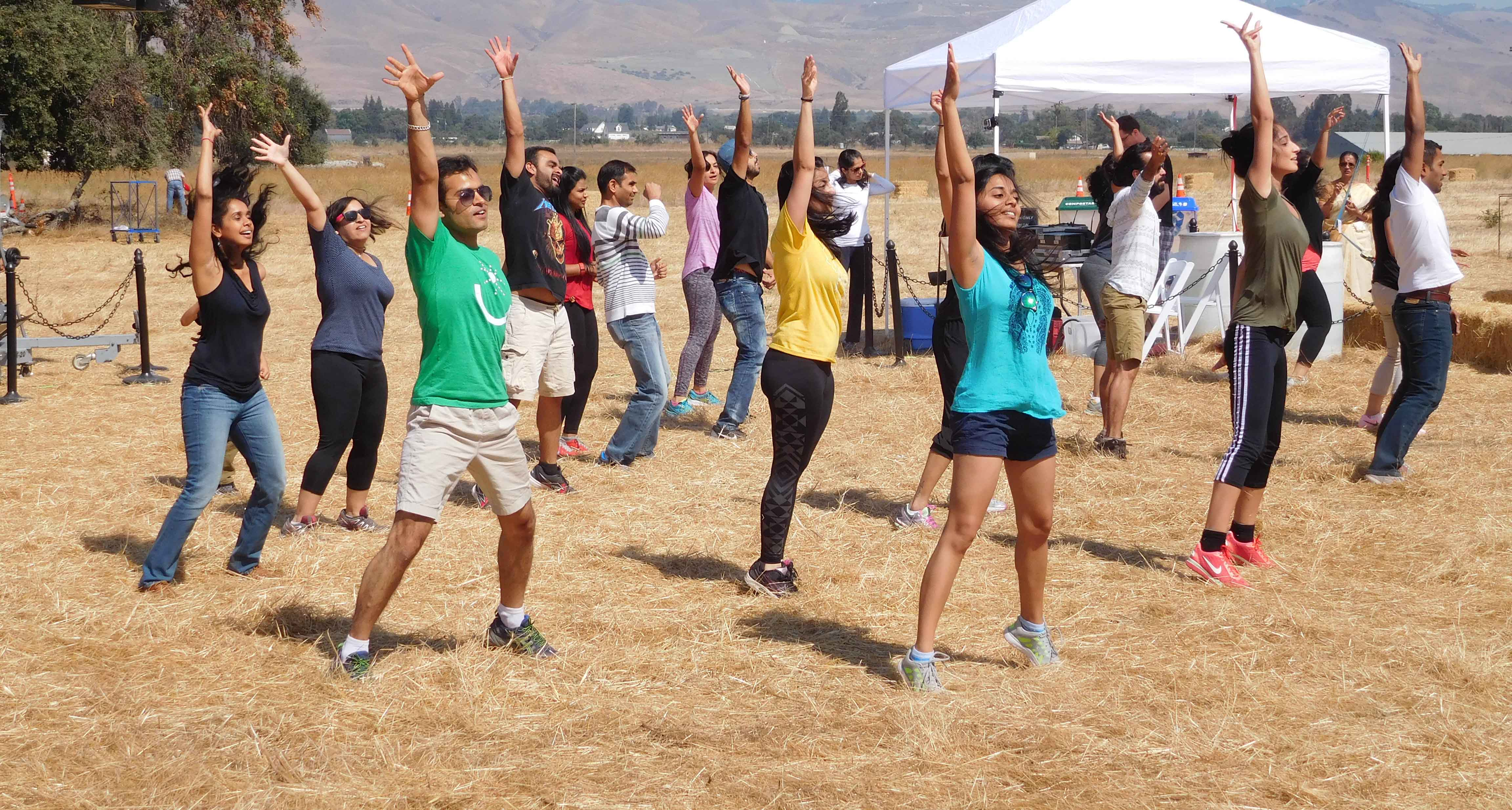 Group of dancers doing choreography at Coyote Valley Family Harvest Feast